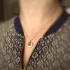Collier pendentif médaille de blanc et d'or